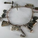 VINTAGE STERLING SILVER CHARM BRACELET AND CHARMS