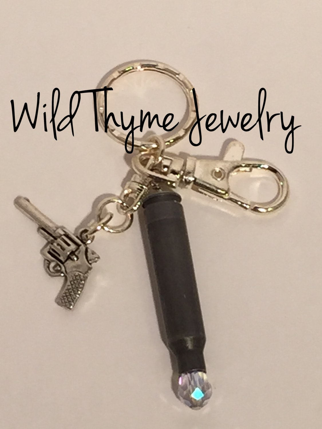 Bullet keychain with pistol charm