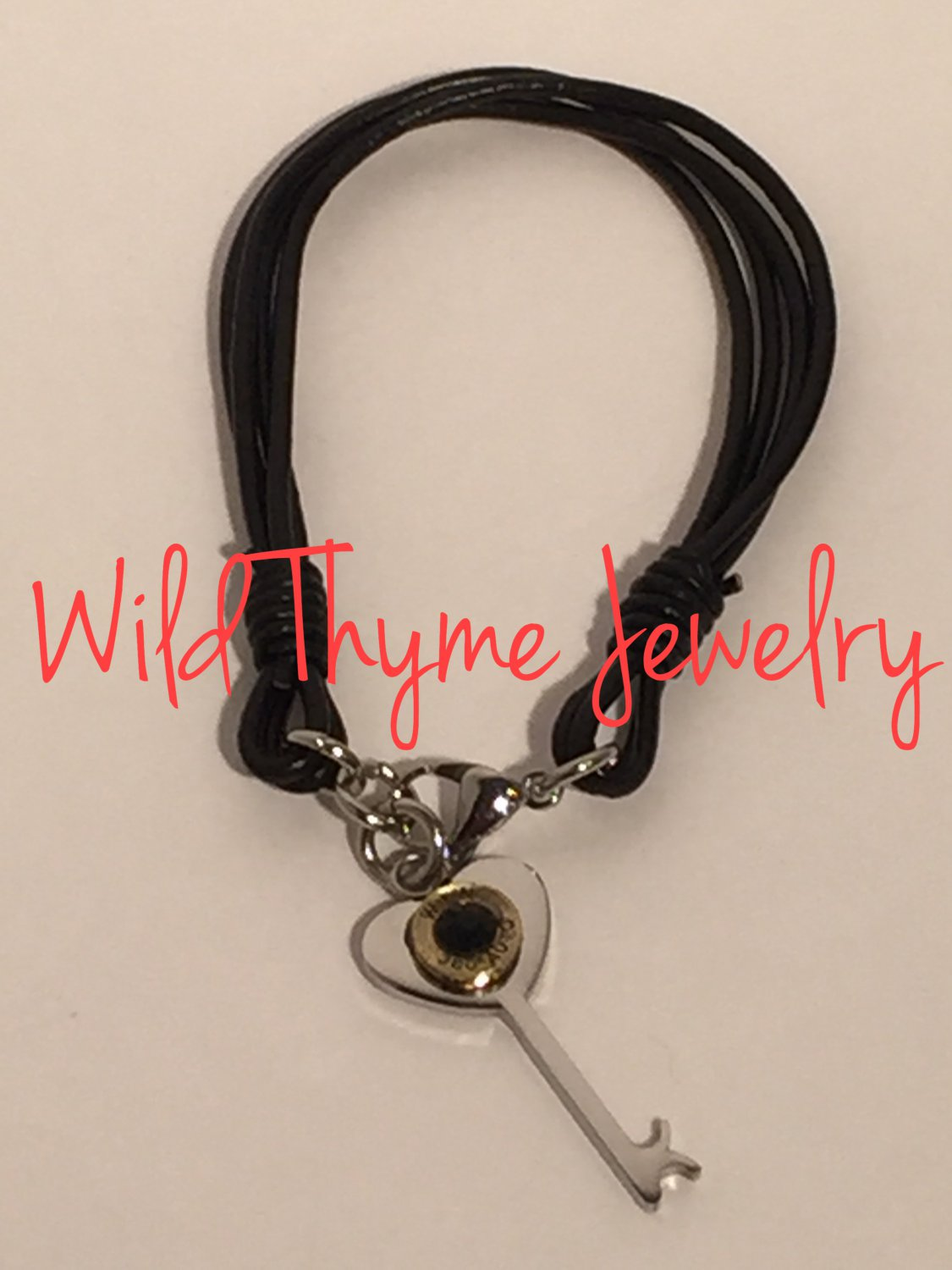 Leather bracelet with heart key and bullet charm