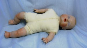 "Small Porcelain Reproduction Baby Doll; 11"" Tall, Cloth Body, Ready to Dress"