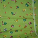 Sewing Fabric Cotton No 305 Sand toys on green