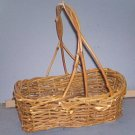 "Basket - Rough weave, w/handle, 11X7X4"" with 13"" hi handle.  Darker than appears in picture"