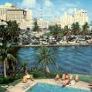 DOWNTOWN MIAMI ACROSS MIAMI RIVER FROM BRICKELL POINT FL. COLOR PICTURE POSTCARD #577 USED 1957