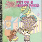 A LITTLE GOLDEN BOOK - PRECIOUS MOMENTS PUT ON A HAPPY FACE CHILDREN'S HB 1992 VERY GOOD