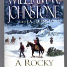 A ROCKY MOUNTAIN CHRISTMAS BY WILLIAM W. JOHNSTONE 2012 PAPERBACK BOOK 1ST ED. MINT
