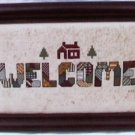 Completed Cross stitch Welcome in a patchwork design framed