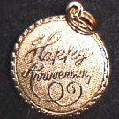 "Charm ""Happy Anniversary"" gold tone circle"
