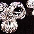 Hobe signed vintage pin silver tone loops flower motif