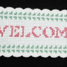 Completed cross stitch finger towel border strip Welcome with hearts