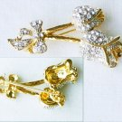 Rhinestone double flower pin gold tone setting bow at base
