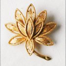 Avon gold tone flower pin circa 1971 tooled metal 1 1/2 inch diameter