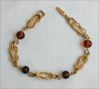 Avon tooled gold tone amber plastic bead bracelet