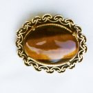 Oval tiger eye pin burnished gold tone setting 1 3/8 inch jewelry