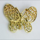 Butterfly pin gold tone marked Gerry jewelry