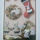 Bunny rabbit motifs on stockings and wreaths patterns by Buckeye Tree