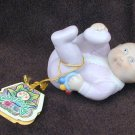 Cabbage Patch baby with rattle and tag OAA 1984 porcelain