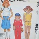 McCall 6529 girls T shirt skirt pants shorts size 8 UNCUT sewing pattern KNITS ONLY