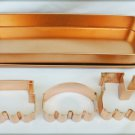 Copper colored engine caboose car train cookie cutter molds in box