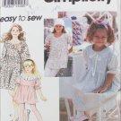 Simplicity 8843 girls dress tunic leggings sizes 8 10 12 14
