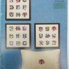 Flower Initials in cross stitch by Mary Ellen pattern booklet