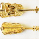 Pin gold tone violin with rhinestones and strings costume jewelry