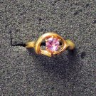 Purple stone ring gold tone setting size 6.75 to 7 unmarked jewelry