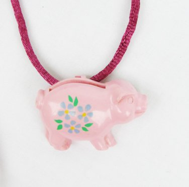 Avon pink piggy bank pig necklace on purple cord