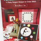 Penguin Pre-Occupations 11 cross stitch designs gone fishing artist lover family