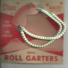ROLL GARTERS- Small- carded pair-  Green  and white-  Vintage.  Vintage.