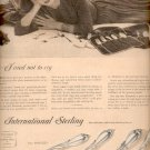 1957   International Sterling- Rhapsody  ad (# 4788)