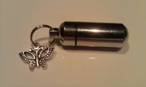 Lovely Silver Cremation Urn Keepsake with Silver Butterfly