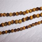 "TIGER EYE 16"" strand 2-4mm Beads"