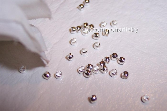 CRIMP BEADS 2 mm SILVER PLATED q.100