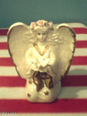 """Knelling Angel holding a Dove"""
