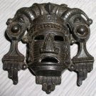 Vintage primitive cast mask brooch