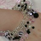 M2MG Posh Boutique IE fringe POODLE bracelet, pink/black