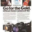 Canon A-1 Official 35mm Camera T50 New F-1 2-page Vintage Ad 1984 Olympics