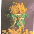 Anne Geddes Postcard 1995 605-107 Baby Yellow Flower Bouquet 4x6