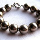 "12mm Mother of Pearl Bead Bracelet Bronze Silvertone Clasp 7.5"" Long"