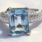 4.23 Carat Light Blue Topaz Ring Sterling Silver .925 Emeral Cut Engraved Shank