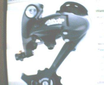 Shimano 7 or 8-speed bicycle rear DERAILLEUR. Color SILVER....derailleurs ... S&H is $6.95 or $2.95