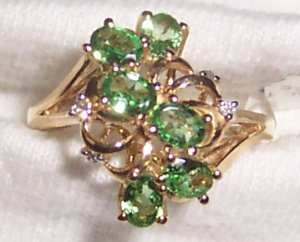 Green stone ring with diamond accents