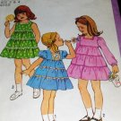Simplicitiy 8429 Sewing Pattern Child's Tiered Dress with Sleeve Variations sizes  3 4 (wiki)