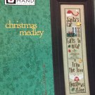 Christmas Medley Heart in Hand Cross stitch pattern