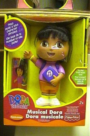 NIB Dora the Explorer Musical Dora toy plays music and talks