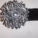 Zebra 4 inch gerbera daisy on a black 1.5 inch crochet headband