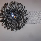 Zebra 4 inch gerbera daisy on a white 1.5 inch crochet headband