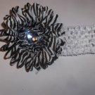 Zebra 4 inch gerbera daisy on a white 1.5 inch crochet headband