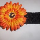 Orange 4 inch Gerbera Daisy hair clip on a black 1.5 inch crochet headband