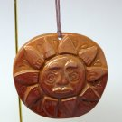 The Earth Shop Christmas ornament handmade clay sun face
